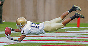 Notre Dame's David Grimes appears to have a touchdown against Stanford but it was overturned after a review of the play.  The ruling caused a great deal of discussion among fans and sports analysts who believe it was clearly a catch.