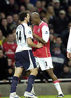Photo: Olly Greenwood.<br />Arsenal v Tottenham Hotspur. Carling Cup Semi Final 2nd leg 31/01/2007. Arseenal's Abou Diaby appears to head butt Spurs Hossam Ghaley