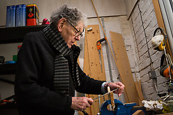 Retired product designer turned toy maker, whose many innovations became iconic household names Tom Karen is photographed with toys he created from recycled materials at his home in Cambridge, UK.<br /> PICTURED: Tom at work in his workshop. <br /> Cambridge, March 01 2018.