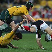 Anthony Fainga'a, Australia, is knocked out as he attempts to tackle Chris Wyles, USA,  during the Australia V USA, Pool C match during the IRB Rugby World Cup tournament. Wellington Stadium, Wellington, New Zealand, 23rd September 2011. Photo Tim Clayton.