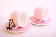 pink teacups on white background