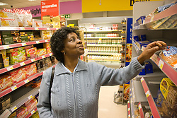 Older woman shopping in a supermarket,