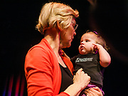 """25 APRIL 2019 - CEDAR RAPIDS, IOWA: US Sen. ELIZABETH WARREN (D MA) holds a baby wearing a tee shirt that says """"Nevertheless she persisted"""" after Warren's campaign speech at the Linn Phoenix Club in Cedar Rapids. Warren's supporters adapted """"Nevertheless she persisted"""" as their own after Mitch McConnell said it to Warren as an insult. The Linn Phoenix Club is an organization that promotes Democratic candidates in Linn County, Iowa. Sen. Warren is campaigning in eastern Iowa Thursday night and Friday to promote her bid to the Democratic candidate for the US Presidency. Iowa traditionally hosts the the first selection event of the presidential election cycle. The Iowa Caucuses will be on Feb. 3, 2020.            PHOTO BY JACK KURTZ"""