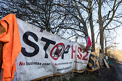 Harefield, UK. 21 January, 2020. A Stop HS2 banner at the Save the Colne Valley Stop HS2 wildlife protection camp on Harvil Road. Activists reoccupied the field behind the roadside camp on 18th January in order to seek to protect ancient woodland set to be destroyed by HS2.