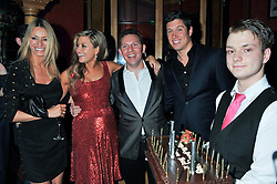 Left to right, TESS DALY, HOLLY VALANCE, NICK CANDY and VERNONKAY with a Birthday cake at the 39th birthday party for Nick Candy in association with Ciroc Vodka held at 5 Cavindish Square, London on 21st Januatu 2012.