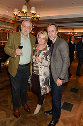 Left to right, Chef PIERRE KOFFMANN, his wife CLAIRE and chef MARCUS WAREING at a party to celebrate the publication of 'Let's Eat meat' by Tom Parker Bowles held at Fortnum & Mason, Piccadilly, London on 21st October 2014.
