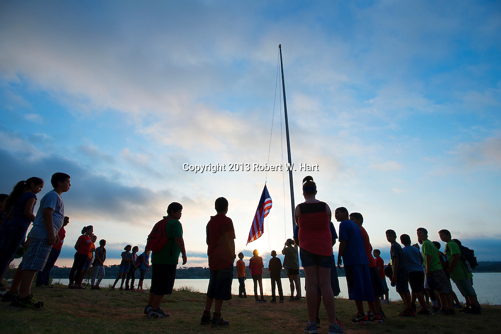 Students from W.T. Francisco Elementary School in Haltom City, Texas, attend a flag-raising ceremony at the beginning of their day at YMCA Camp Grady Spruce facility on Possum Kingdom Lake in Palo Pinto County, Texas. The students spent three days at camp studying science in the school's outdoor education program.<br /> <br /> Robert W. Hart/Special Contributor