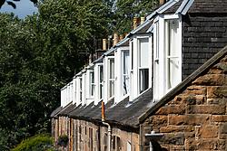 Exterior view of row of windows of Colony style terraced houses in Stockbridge, Edinburgh, Scotland, UK