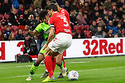 Norwich City midfielder Onel Hernandez (25) nutmegs Middlesbrough defender George Friend (3) during the EFL Sky Bet Championship match between Middlesbrough and Norwich City at the Riverside Stadium, Middlesbrough, England on 30 March 2019.