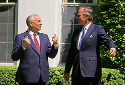 United States President George H.W. Bush, right, in conversation with President Mikhail Gorbachev of the Union of Soviet Socialist Republics, left, as they walk to Gorbachev's car following a state arrival ceremony on the South Lawn of the White House in Washington, DC on Thursday, May 31, 1990. It was the start of three days of talks between the two leaders. Photo by Ron Sachs / CNP /ABACAPRESS.COM