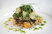 May0018068 . Daily Telegraph..The main of Portobello Mushrooms stuffed with Artichoke with a Pearl Barley and Butternut Squash risotto ....  that has been  prepared for the Vegan lunch that is being prepared whilst they're attending the 3 day Alliance for Religion and Conservation event in Windsor...Windsor 2 November 2009