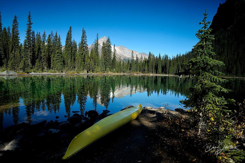 Yellow Kayak on shore of Lake O'Hara, Yoho National Park, BC, Canada