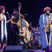 WASHINGTON, DC - August 26, 2015 - Patrice Quinn, Miles Mosely and Kamasi Washington perform at the Howard Theatre in Washington, D.C. After working with artists such as Kendrick Lamar and Flying Lotus, Washington is touring behind his debut studio album, The Epic.  (Photo by Kyle Gustafson / For The Washington Post)