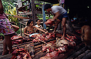 Asia, South East Asia, Borneo, Sarawak. Penan, nomadic hunter-gatherers share their kill of wild boar equally amongst all the people of their village. Dayak peoples of Borneo. 1991.'MEAT' across the World..foto © Nigel Dickinson