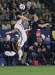 June 24, 2017 - Carson, California, U.S - Romain Alessandrini #7 of Los Angeles Galaxy battles for the ball during their game against Sporting KC at the StubHub Center on Saturday June 24, 2017 in Carson, California.  LA Galaxy loses to Sporting KC, 2-1. (Credit Image: © Prensa Internacional via ZUMA Wire)