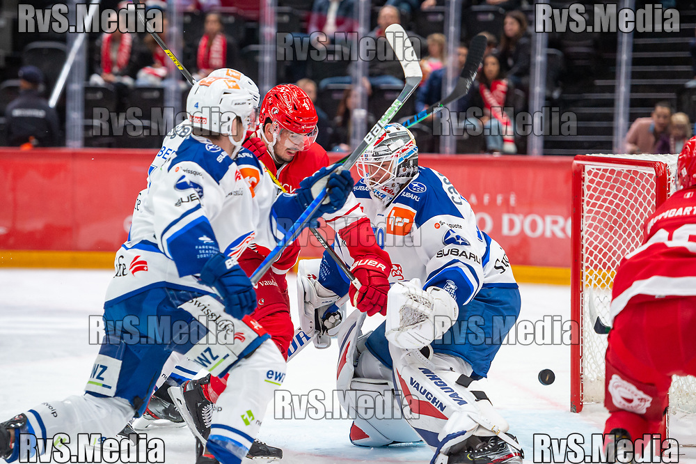 LAUSANNE, SWITZERLAND - OCTOBER 01: Jason Fuchs #14 of Lausanne HC (not on the photo) scores a goal against Goalie Lukas Flueler #30 of ZSC Lions during the Swiss National League game between Lausanne HC and ZSC Lions at Vaudoise Arena on October 1, 2021 in Lausanne, Switzerland. (Photo by Monika Majer/RvS.Media)