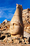 Picture & photo of the statues of around the tomb of Commagene King Antochus 1 on the top of Mount Nemrut, Turkey. Stock photos & Photo art prints. In 62 BC, King Antiochus I Theos of Commagene built on the mountain top a tomb-sanctuary flanked by huge statues (8–9 m/26–30 ft high) of himself, two lions, two eagles and various Greek, Armenian, and Iranian gods. The photos show the broken statues on the  2,134m (7,001ft)  mountain. 3 .<br /> <br /> If you prefer to buy from our ALAMY PHOTO LIBRARY  Collection visit : https://www.alamy.com/portfolio/paul-williams-funkystock/nemrutdagiancientstatues-turkey.html<br /> <br /> Visit our CLASSICAL WORLD HISTORIC SITES PHOTO COLLECTIONS for more photos to download or buy as wall art prints https://funkystock.photoshelter.com/gallery-collection/Classical-Era-Historic-Sites-Archaeological-Sites-Pictures-Images/C0000g4bSGiDL9rw