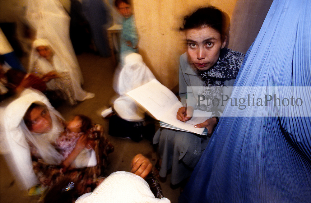 BAHARAK HOSPITAL, 28 July 2005...In the corridor  mothers wait for their children to get vaccinated. A nurse writes down their names.....The clinic provides children immunization against Tetanus, Polio, Thubercolosi and Diphtheria...The clinic is supported by UNFPA