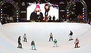 SHOT 1/25/08 7:26:10 PM - Young volunteers on snowboards make their way down the superpipe clearing snow from the transition Friday January 25, 2008 at Winter X Games Twelve in Aspen, Co. at Buttermilk Mountain. The 12th annual winter action sports competition features athletes from across the globe competing for medals and prize money is skiing, snowboarding and snowmobile. Numerous events were broadcast live and seen in more than 120 countries. The event will remain in Aspen, Co. through 2010..(Photo by Marc Piscotty / © 2008)