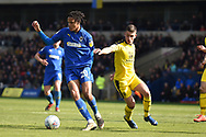 AFC Wimbledon defender Toby Sibbick (20) battles for possession  with Oxford United midfielder Cameron Brannagan (8) during the EFL Sky Bet League 1 match between Oxford United and AFC Wimbledon at the Kassam Stadium, Oxford, England on 13 April 2019.