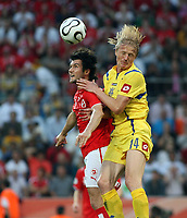 Photo: Chris Ratcliffe.<br /> Switzerland v Ukraine. 2nd Round, FIFA World Cup 2006. 26/06/2006.<br /> Andriy Gusin of Ukraine clashes with Raphael Wicky of Switzerland.