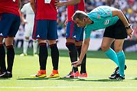 Referee using the spray during a match of La Liga Santander at Santiago Bernabeu Stadium in Madrid. September 10, Spain. 2016. (ALTERPHOTOS/BorjaB.Hojas)