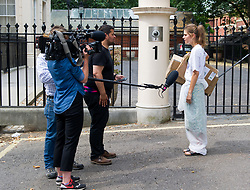 July 26, 2018 - London, London, United Kingdom - Campaigners outside Carlton House. .A campaigner attends the press during the protest outside Carlton House...Campaigners from For our Future's Sake and Our Future our Choice seen outside Carlton House offering Boris Johnson to help him to leave the Foreign Secretary house. (Credit Image: © Gustavo Valiente/i-Images via ZUMA Press)