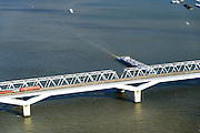 Nederland, Zuid-Holland, Gemeente Strijen, 23-10-2013; HSL-brug over het Hollandsch Diep, Moerdijkbrug. De trein is een intercity direct (voorheen Fyra), onderweg naar Breda. <br /> HSL bridge over the Moerdijk The train is a 'intercity direct' (formerly Fyra), en route to Breda.<br /> luchtfoto (toeslag op standard tarieven);<br /> aerial photo (additional fee required);<br /> copyright foto/photo Siebe Swart