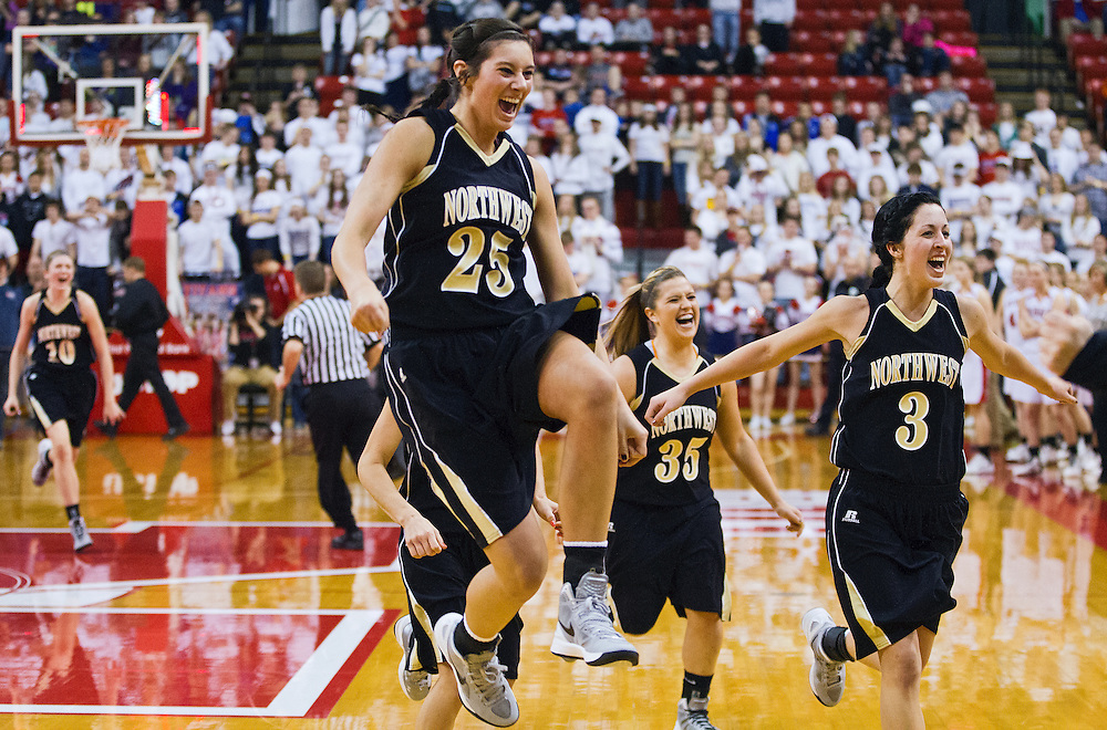 Grand Island Northwest's Erin Schleicher (25), Shelby Schacher (35), and Kaley Werner (3) along with Katie Plackie, back left, celebrate their 62-51 double-overtime victory over Norris in Saturday's Class B State Championship at the Davaney Sports Center in Lincoln. (Independent/Matt Dixon)