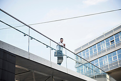 Low angle view of a businessman standing on bridge, Munich, Bavaria, Germany