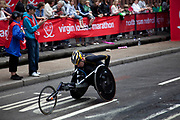 Competitor in the wheel chair race in the 2010 Virgin London Marathon. Upper Thames Street.