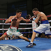 KISSIMMEE, FL - MARCH 06:  Jonathan Oquendo (R) and Gabino Cota fight for the WBO Latino Flyweight Title during the Telemundo Boxeo boxing match at the Kissimmee Civic Center on March 6, 2015 in Kissimmee, Florida. Oquendo won the belt after a 10 round unanimous decision on the scorecards. (Photo by Alex Menendez/Getty Images) *** Local Caption *** Jonathan Oquendo; Gabino Cota