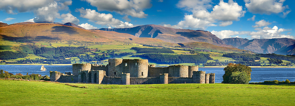Beaumaris Castle, looking towards Snowdonia,  built in 1284 by Edward 1st, considered to be one of the finest example of 13th century military architecture by UNESCO. A Unesco World Heritage Site. Beaumaris, Anglesey Island, Wales. .<br /> <br /> Visit our WALES HISTORIC PLACES PHOTO COLLECTIONS for more photos to browse or download or buy as prints https://funkystock.photoshelter.com/gallery-collection/Images-of-Wales-Welsh-Historic-Places-Pictures-Photos/C0000UEicBhu1tQM<br /> .<br /> Visit our MEDIEVAL PHOTO COLLECTIONS for more   photos  to download or buy as prints https://funkystock.photoshelter.com/gallery-collection/Medieval-Middle-Ages-Historic-Places-Arcaeological-Sites-Pictures-Images-of/C0000B5ZA54_WD0s