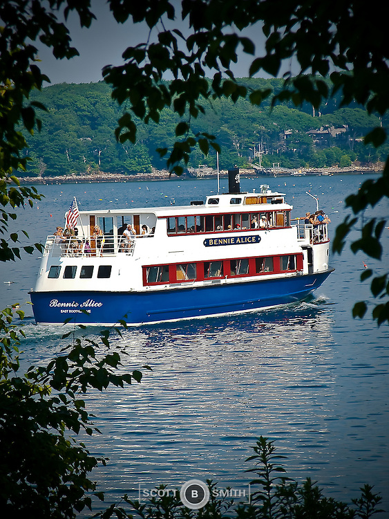 The Bennie Alice tour boat taking tourists back to Boothbay Harbor Maine after a clambake lunch on privately owned Cabbage Island.