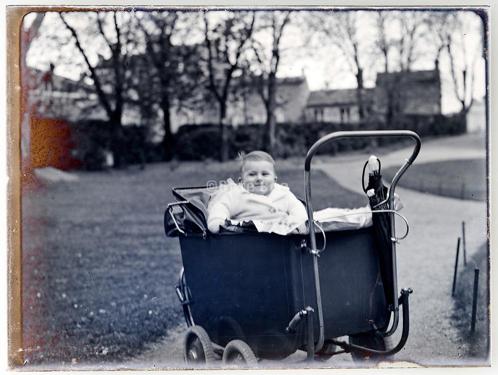 toddler in stroller posing late 1920s