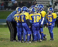 Salisbury Mills, New York -Washingtonville players huddle before a play during an Orange County Youth Football League game on Oct. 16, 2010.