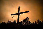 A cross remains standing at Foothills Elementary School after the Glass Fire passed through Napa Valley, CA on September 28, 2020. The wildfire went from 1,500 acres to more than 15,000 acres overnight as winds spread embers across the valley.