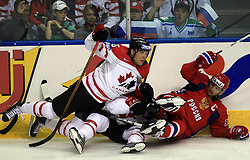 Ed Jovanovski (55) of Canada on Jamal Mayers (21) of Canada and Alexei Morozov (95) of Russia at  ice-hockey game Canada vs Russia at finals of IIHF WC 2008 in Quebec City,  on May 18, 2008, in Colisee Pepsi, Quebec City, Quebec, Canada. Win of Russia 5:4 and Russians are now World Champions 2008. (Photo by Vid Ponikvar / Sportal Images)