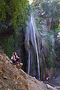 Woman Sitting On the Rocks at Nojoqui Falls Park Santa Ynez Valley near Solvang