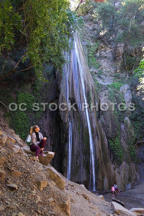 Woman Sitting On the Rocks at Nojoqui Falls Park Santa Ynez Valley near Solvang