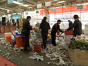 end of the day at a flower market Beijing China