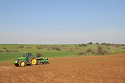 A planter is a farm implement, usually towed behind a tractor, that sows (plants) seeds in rows throughout a field