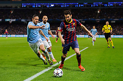 Barcelona Midfielder Cesc Fabregas (ESP) is challenged by Man City Defender Martin Demichelis (ARG) - Photo mandatory by-line: Rogan Thomson/JMP - Tel: 07966 386802 - 18/02/2014 - SPORT - FOOTBALL - Etihad Stadium, Manchester - Manchester City v Barcelona - UEFA Champions League, Round of 16, First leg.