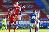 Cardiff City's Marlon Pack (21) competes for a high ball with  Nottingham Forest's Ryan Yates (22) with Sammy Ameobi (11) looking on during the EFL Sky Bet Championship match between Cardiff City and Nottingham Forest at the Cardiff City Stadium, Cardiff, Wales on 2 April 2021.