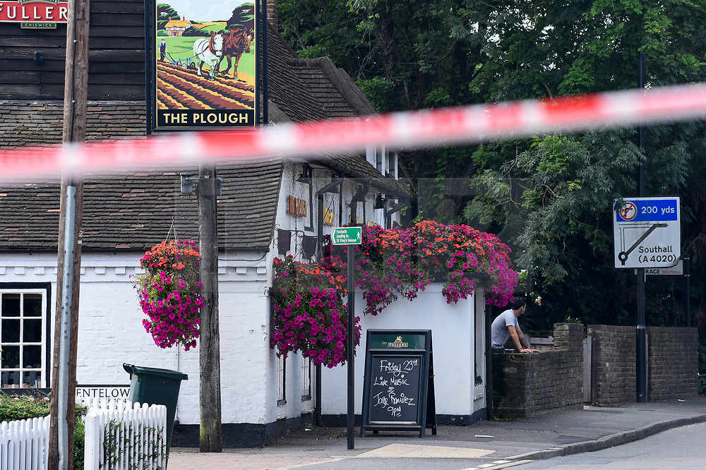 © Licensed to London News Pictures. 25/08/2019. SOUTHALL, UK.  The scene adjacent to St Mary's Avenue near Southall in west London.  It is reported that a man in his 60s was stabbed outside The Plough pub (pictured left) on Tentelow Avenue in the early evening of 24 August and stumbled to nearby St Mary's Avenue to seek aid from a residence.  Police were called at 6.41pm, paramedics and air ambulance crews attended but the man passed away.  A man in his 30s has been arrested on suspicion of murder.  The investigation continues. Photo credit: Stephen Chung/LNP