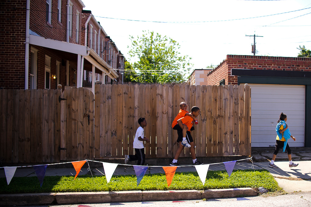 photo by Matt Roth.Friday, May 11, 2012...AFYA Mile Race Day! .Pre-race Activities (beginning at approx 8:30).Students are in classrooms eating breakfast, putting on numbers, etc...The Race: starting line is the corner of Harford Road and Chesterfield Ave.  Finish line is the school yard.  We have about 320 students running in grades 6, 7, and 8.  So that means about 12 groups of students will run the race between 9 and 11:45. ..Starting line: in Herring Run Park at the corner of Harford Rd. and Chesterfield Ave.  Classes walk up there to gather and stretch before their start.  They start at 15 minute intervals...The course: winds through a path in Herring Run park (probably hard to get photos here)..Cardio Hill: this is toward the end of the race; it's where the race path comes out from the woods. Students run up the grassy hill. The top of the hill is at the corner of Chesterfield and Cardenas...Finish line: on the school yard..Once students finish the race they work their way through a series of stations and stay to cheer on their peers...Post-race Activities.In classrooms signing numbers, getting t-shirts, snacks, attend Health Expo (this is in a big room on the first floor; eighth graders did health projects)