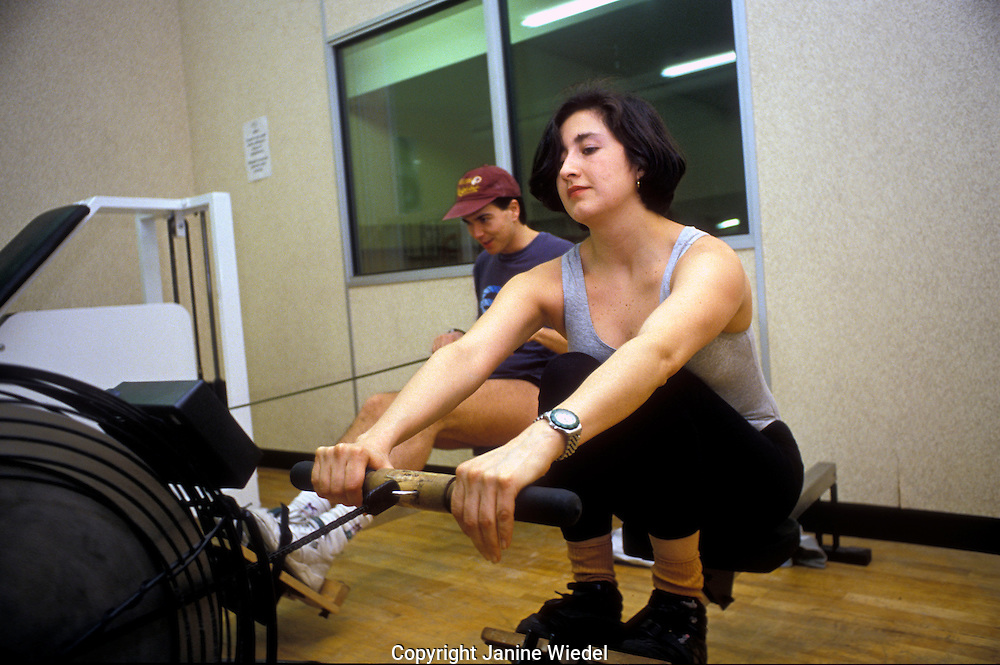 Young woman working out in the gym.