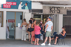 © Licensed to London News Pictures.  29/06/2021. Magaluf, Spain. British holidaymakers queue to get a PCR test in Magaluf. Balearic Islands will go on the UK 'green list' from tomorrow, 4am. Prime Minister of Spain, Pedro Sanchez announced the new rules for Brits coming to Mallorca, Ibiza and other Balearic Islands. Brits willing to visit must have show a proof of vaccination or negative PCR test. Photo credit: Marcin Nowak/LNP