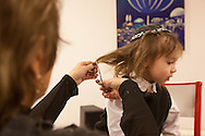 France. Saint Maur des fosses.  Jewish ceremony, the Halakah, first hair cut for the son of the rabbi, He is three years old