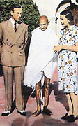 Mohondas Karamchand Gandhi  (1869-1948), known as Mahatma (Great Soul). Indian Nationalist leader. Here he stands between Lord and Lady Mountbatten.